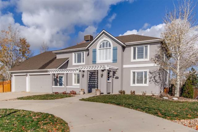 14091 W 63rd Place, Arvada, CO 80004 (#3513443) :: The DeGrood Team