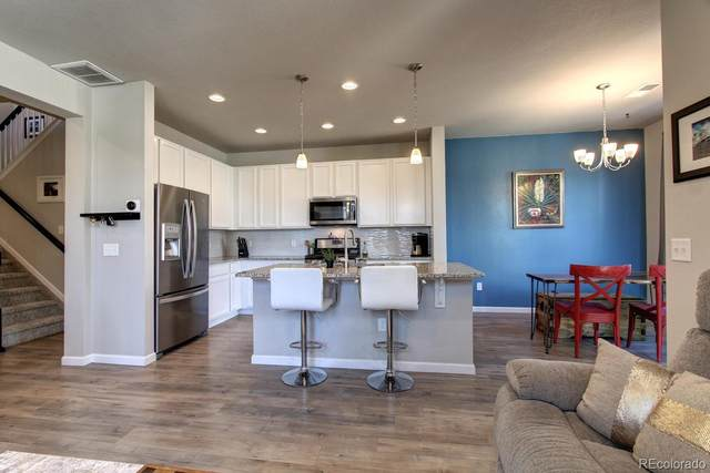 15541 W 64th Place D, Arvada, CO 80007 (#8649284) :: West + Main Homes