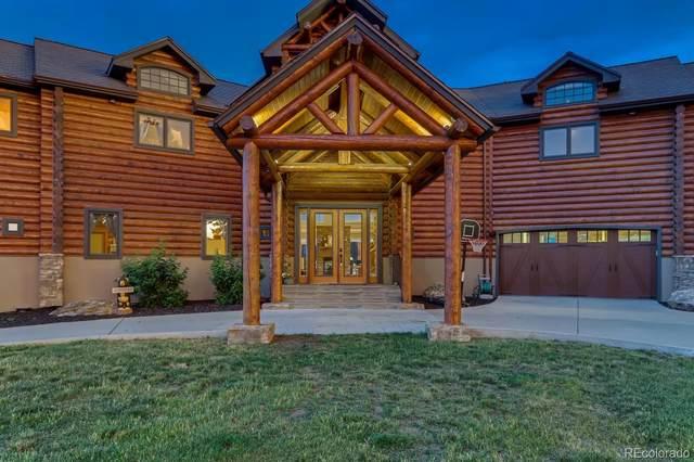 9395 Moonlight Drive, Littleton, CO 80127 (#2610573) :: iHomes Colorado