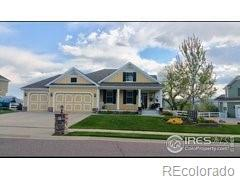 11674 W 76th Lane, Arvada, CO 80005 (#3652976) :: The Healey Group