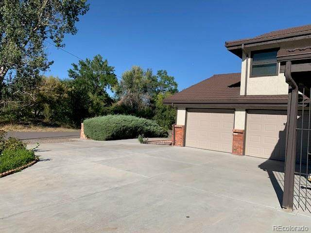 9800 E Kentucky Drive, Denver, CO 80247 (#6018504) :: The Gilbert Group