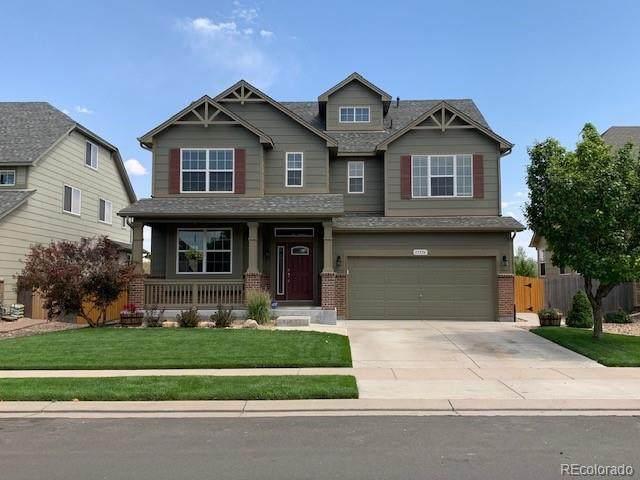 11336 River Oaks Lane, Commerce City, CO 80640 (MLS #8815960) :: 8z Real Estate