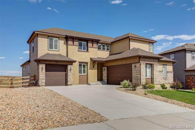 16145 W 84th Lane, Arvada, CO 80007 (#7202554) :: The Healey Group