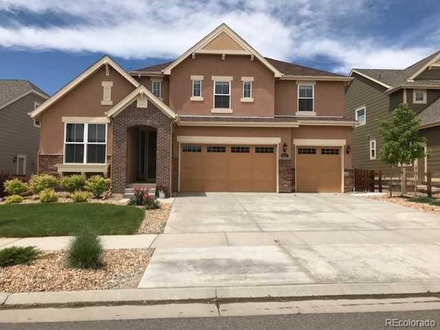 9457 Iron Mountain Way, Arvada, CO 80007 (#8034291) :: Wisdom Real Estate
