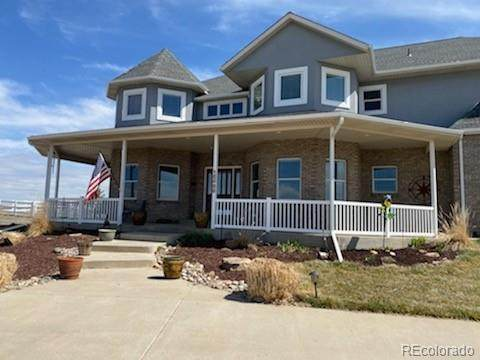 15000 Overland Trail, Brighton, CO 80603 (#5888883) :: The Peak Properties Group