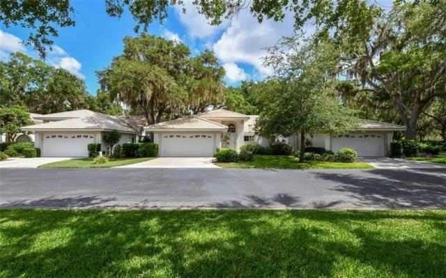 7013 Woodside Oaks Circle, Sarasota, FL 34231 (MLS #A4436275) :: Sarasota Home Specialists