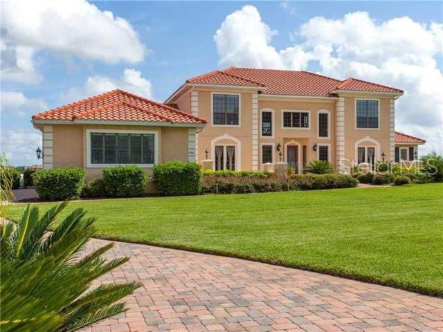 13605 Lake Cawood Dr, Windermere, FL 34786 (MLS #A4438654) :: The Edge Group at Keller Williams