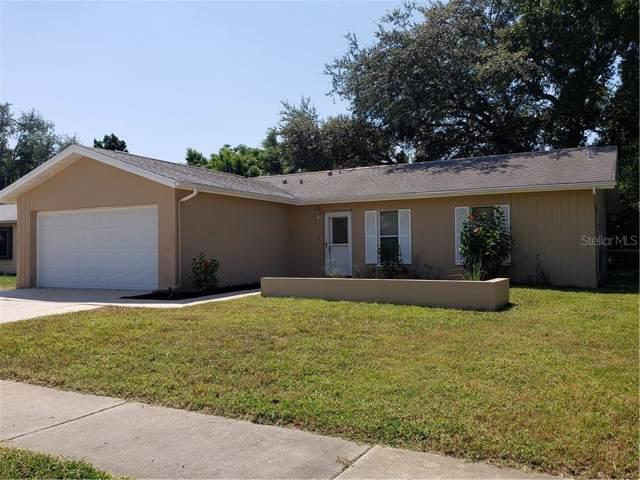10325 Leaning Oak Drive, Port Richey, FL 34668 (MLS #A4446049) :: Cartwright Realty