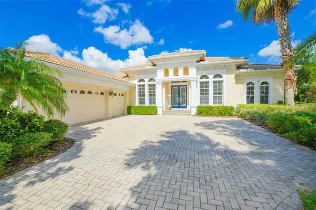 7063 Twin Hills Terrace, Lakewood Ranch, FL 34202 (MLS #A4449370) :: Kendrick Realty Inc