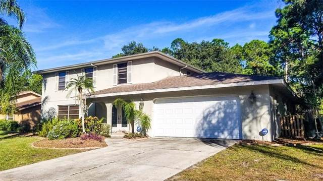 8019 Conservatory Drive, Sarasota, FL 34243 (MLS #A4453523) :: Sarasota Home Specialists