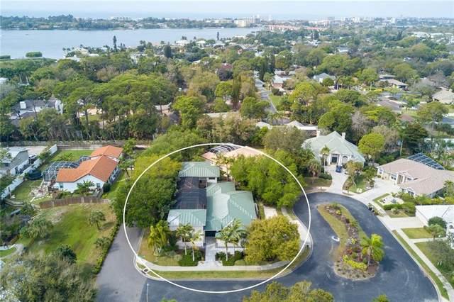 7125 Roland Oaks Circle, Sarasota, FL 34231 (MLS #A4461128) :: Sarasota Home Specialists