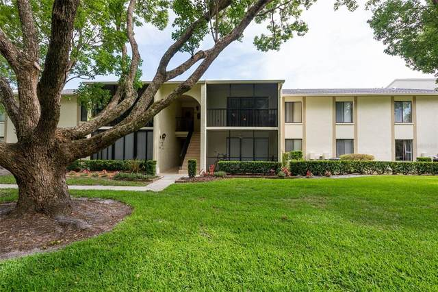 3211 Lake Pine Way E F1, Tarpon Springs, FL 34688 (MLS #A4500631) :: Coldwell Banker Vanguard Realty