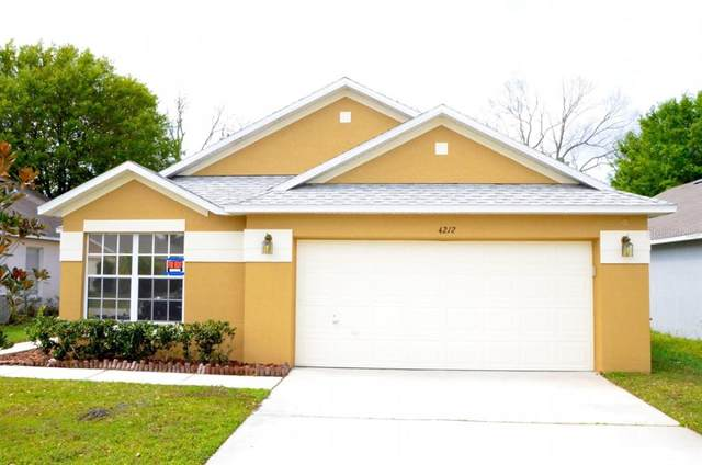 4212 Boca Woods Drive, Orlando, FL 32826 (MLS #A4504476) :: Team Bohannon
