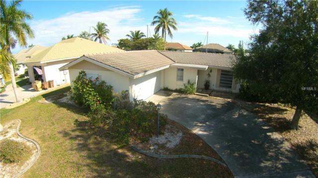 2471 Palm Tree Drive, Punta Gorda, FL 33950 (MLS #C7410496) :: RE/MAX CHAMPIONS