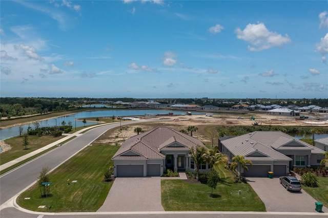 15000 Spanish Point Drive, Port Charlotte, FL 33981 (MLS #D6118667) :: Visionary Properties Inc