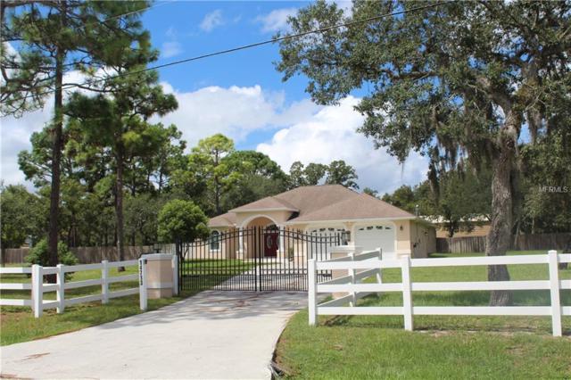 14713 Thompson Avenue, Hudson, FL 34669 (MLS #E2400517) :: Delgado Home Team at Keller Williams
