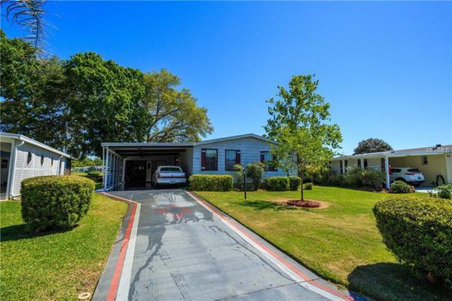 936 Saint Andrews Boulevard, Lady Lake, FL 32159 (MLS #G5000334) :: Cartwright Realty