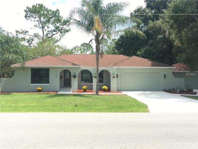 9845 County Road 121, Wildwood, FL 34785 (MLS #G5006397) :: Delgado Home Team at Keller Williams