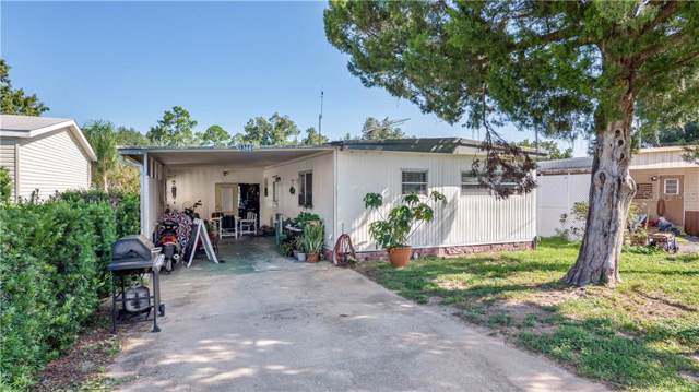 13441 Woodland Drive, Astatula, FL 34705 (MLS #G5020586) :: Griffin Group
