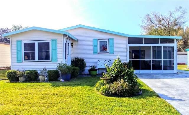 1852 W Schwartz Boulevard, Lady Lake, FL 32159 (MLS #G5027317) :: Bob Paulson with Vylla Home