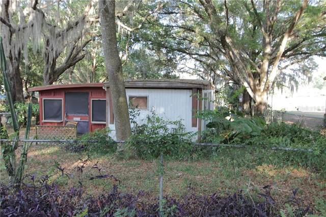 37402 Happy Lane, Lady Lake, FL 32159 (MLS #G5028213) :: Keller Williams Realty Peace River Partners
