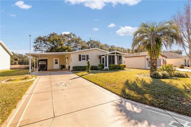 1331 E Schwartz Boulevard, Lady Lake, FL 32159 (MLS #G5037556) :: Everlane Realty