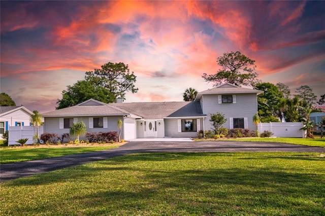 16047 E Shirley Shores Road, Tavares, FL 32778 (MLS #G5040747) :: Visionary Properties Inc