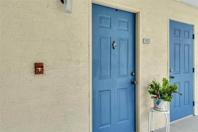 7210 Westpointe Boulevard #1311, Orlando, FL 32835 (MLS #G5044257) :: Frankenstein Home Team