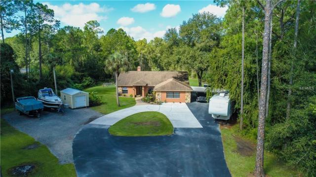 7737 Westpoint Drive, Wesley Chapel, FL 33544 (MLS #H2400882) :: The Duncan Duo Team