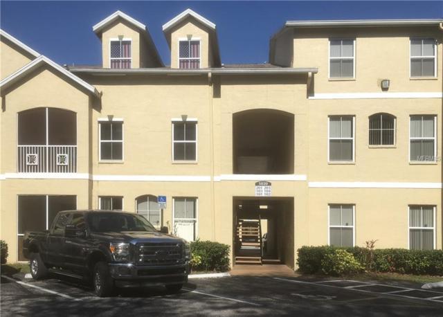 5020 Sunridge Palms Drive #102, Tampa, FL 33617 (MLS #L4900614) :: Delgado Home Team at Keller Williams