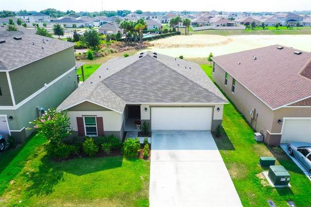 450 Sunfish Dr, Winter Haven, FL 33881 (MLS #L4922816) :: The Kardosh Team