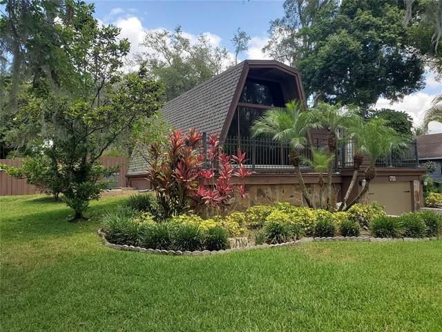711 Lakeshore Drive, Polk City, FL 33868 (MLS #L4922845) :: The Hesse Team
