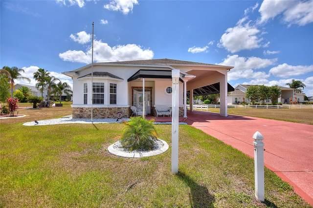 1039 Motorcoach Drive, Polk City, FL 33868 (MLS #L4922956) :: Everlane Realty
