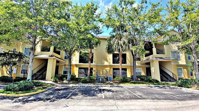 2572 Robert Trent Jones Drive #1215, Orlando, FL 32835 (MLS #O5573950) :: Bustamante Real Estate