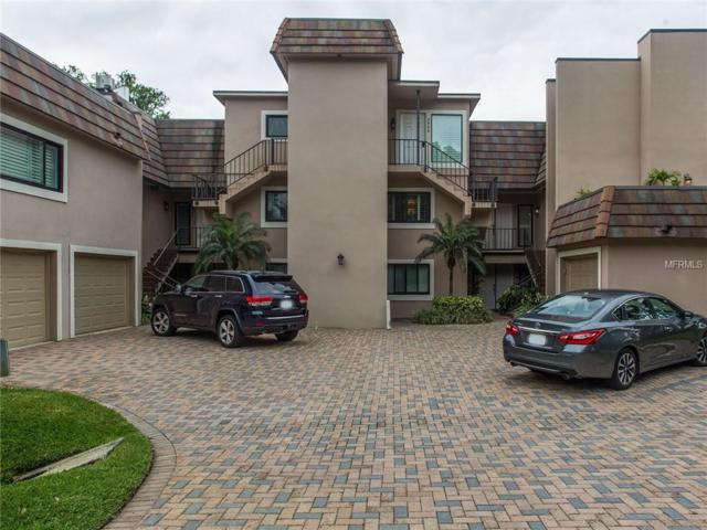 8992 Houston Place #204, Orlando, FL 32819 (MLS #O5703999) :: The Duncan Duo Team