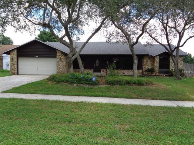 5785 Tamarack Drive, Orlando, FL 32819 (MLS #O5719614) :: Lovitch Realty Group, LLC