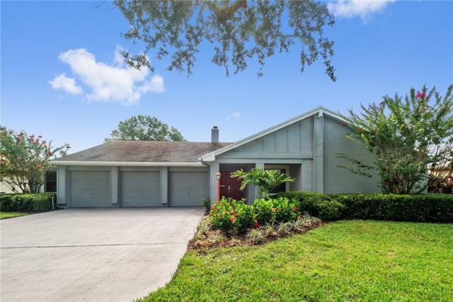 6017 Shore Line Drive, Orlando, FL 32819 (MLS #O5720372) :: G World Properties