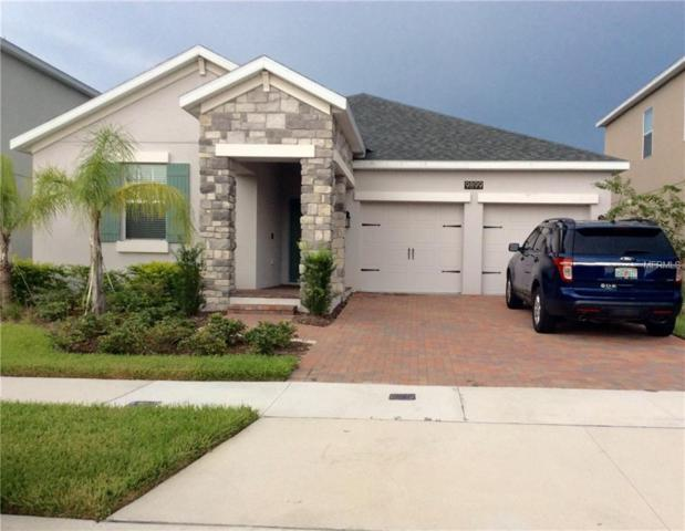 9899 Magnolia Woods Boulevard, Orlando, FL 32832 (MLS #O5721249) :: Griffin Group