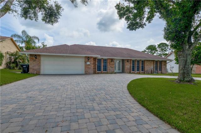 7623 Pine Springs Drive, Orlando, FL 32819 (MLS #O5721953) :: Premium Properties Real Estate Services