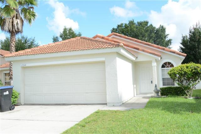 12544 Sophiamarie Loop, Orlando, FL 32828 (MLS #O5725597) :: The Duncan Duo Team