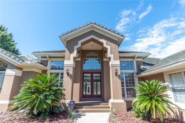 2144 Langley Circle, Orlando, FL 32835 (MLS #O5725729) :: G World Properties