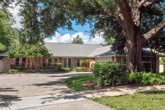 7710 White Ash Street, Orlando, FL 32819 (MLS #O5733164) :: Lovitch Realty Group, LLC
