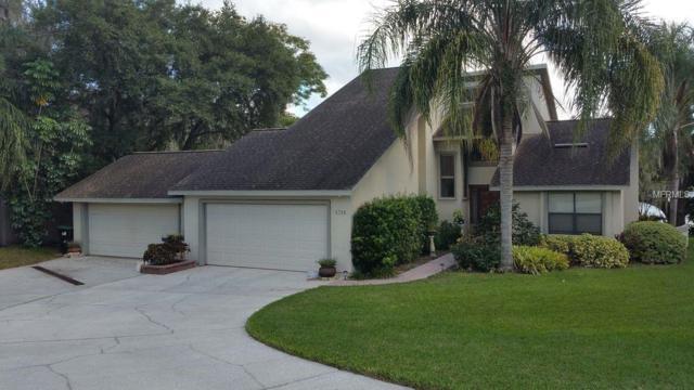 8700 Rose Lake Shore Lane, Orlando, FL 32835 (MLS #O5750812) :: Homepride Realty Services