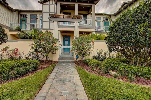 8320 Tavistock Lakes Boulevard, Orlando, FL 32827 (MLS #O5770669) :: Premium Properties Real Estate Services
