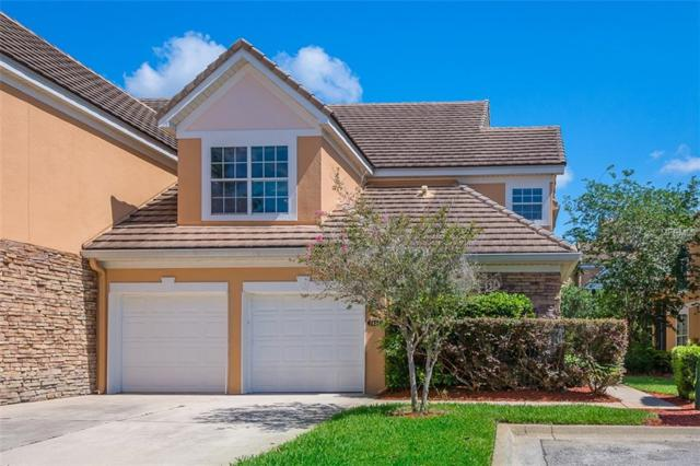 7411 Green Tree Dr #104, Orlando, FL 32819 (MLS #O5785321) :: The Duncan Duo Team