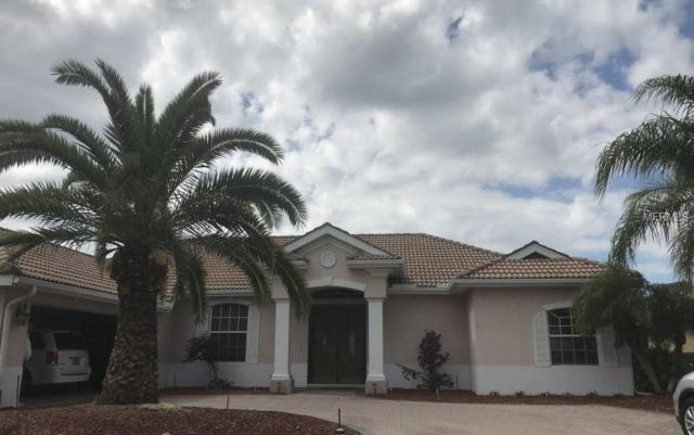 11921 Woodland Terrace, Parrish, FL 34219 (MLS #O5785596) :: White Sands Realty Group