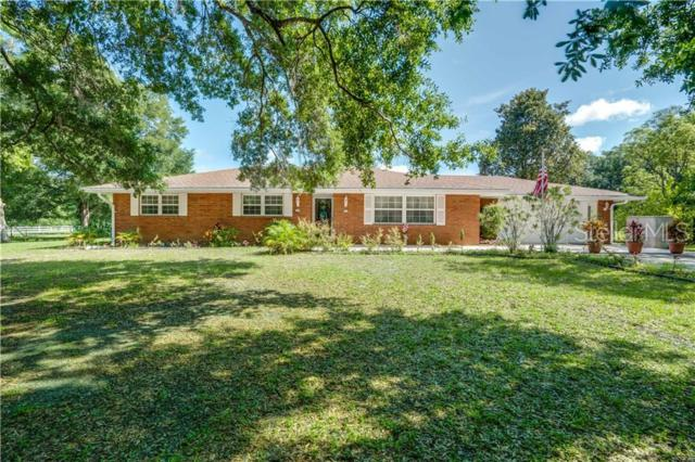 15077 Lake Pickett Road, Orlando, FL 32820 (MLS #O5791213) :: Griffin Group