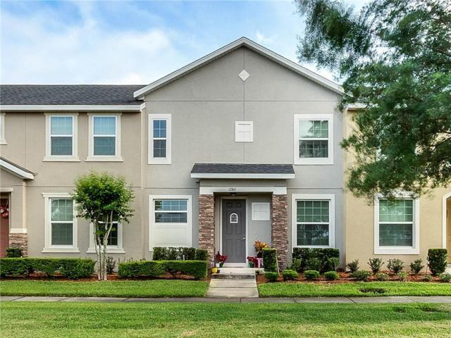 12861 Tanja King Boulevard, Orlando, FL 32828 (MLS #O5796409) :: Delgado Home Team at Keller Williams