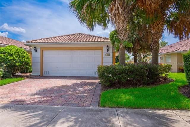 11863 Delfina Lane, Orlando, FL 32827 (MLS #O5797703) :: GO Realty