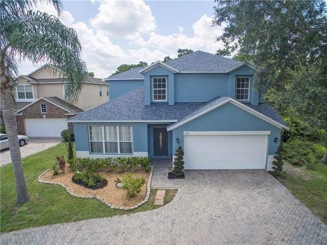 1543 Lalique Lane, Orlando, FL 32828 (MLS #O5799715) :: The Edge Group at Keller Williams